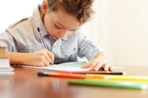 Boy writing at home