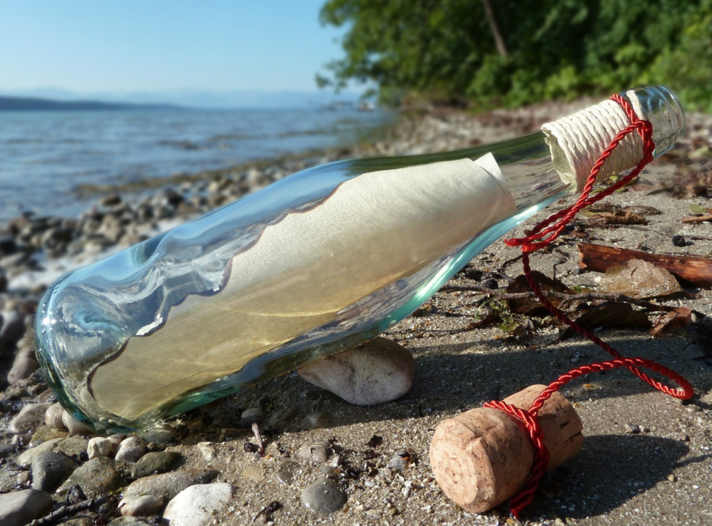 handwritten message in a bottle
